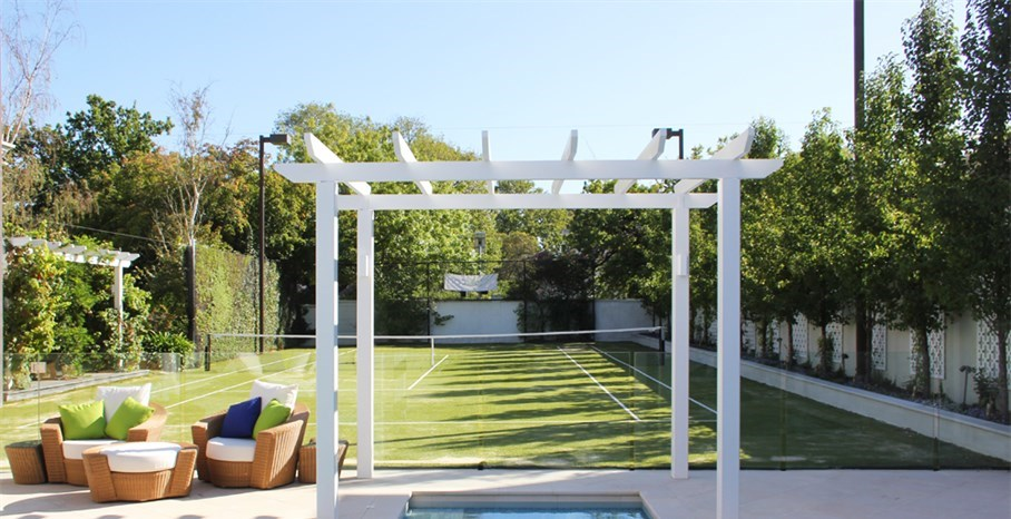 Renovated pool and tennis court in Melbourne, with new sandstone paving laid in a diamond pattern to be in keeping with the property.  Pergola added over the spa area to match existing structure.  Pool fencing changed from steel panels to frameless glass. contemporary pool designs and landscaping, pool plants landscaping, swimming pool landscaping, contemporary pool designs and landscaping.