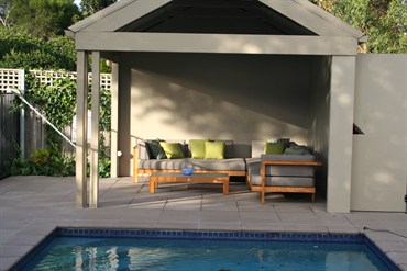 Poolside cabana with contemporary furniture.