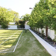 Rejuvenated tennis court and feature planting.