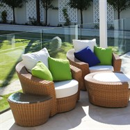 Contemporary outdoor furniture in landscaped setting.