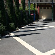 Driveway, period insert pattern, in asphalt and paving