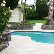 Revamped sandstone paving around existing pool.