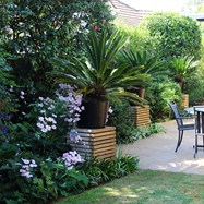 Art Deco Garden, matching piers with highlighted focal planting.