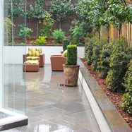 Rear garden excavated to accommodate large rear courtyard, paved with random rectangular paving.  All gardens retained with rendered block walls and capped with bluestone.  Formal hedging planted to hide fence lines.